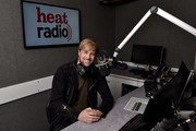 (EXCLUSIVE COVERAGE) Kian Egan poses as he is unveiled as heat radio's new presenter at heat radio on March 16, 2015 in London, England.