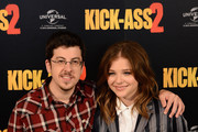 """Actors Christopher Mintz Plasse and Chloe Grace Moretz attend the """"Kick-Ass 2"""" Photocall at Claridges Hotel on August 5, 2013 in London, England."""