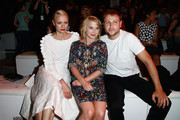 Franziska Knuppe, Anna Maria Muehe and Max Riemelt attend the Kilian Kerner show during the Mercedes-Benz Fashion Week Spring/Summer 2015 at Erika Hess Eisstadion on July 8, 2014 in Berlin, Germany.