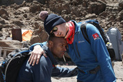 IMAGES AVAILABLE FREE OF CHARGE FOR EDITORIAL USE FOR 48 HOURS FROM CREATE DATE) (STRICTLY EDITORIAL USE ONLY)  Osi Umenyiora and Dan Walker hug during day six of of 'Kilimanjaro: The Return' for Red Nose Day on February 28, 2019 in Arusha, Tanzania, all to raise funds for Comic Relief supported projects in the UK and around the world.