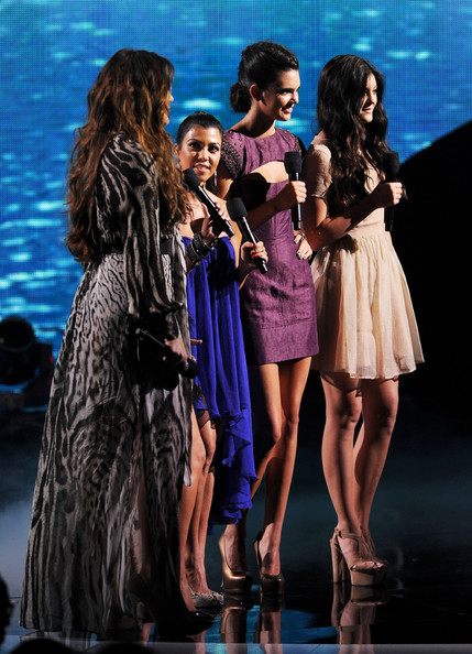 Kim Kardashian (L-R) Khloe Kardashian, Kim Kardashian, Kendall Jenner, and Kylie Jenner onstage during the 2011 Teen Choice Awards held at the Gibson Amphitheatre on August 7, 2011 in Universal City, California.