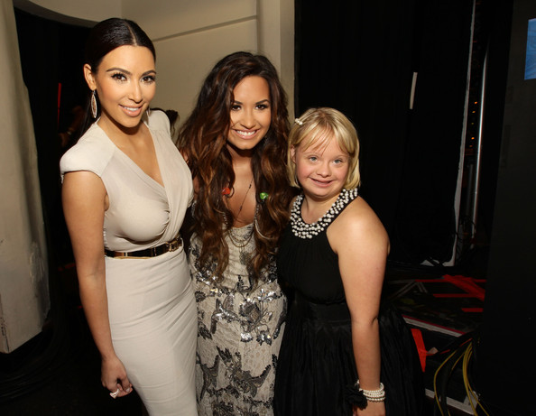 Kim Kardashian TV Personality Kim Kardashian, actress/singer Demi Lovato and actress Lauren Potter attend the 2011 VH1 Do Something Awards at the Hollywood Palladium on August 14, 2011 in Hollywood, California.