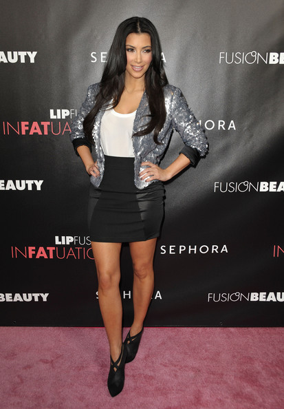 """Television personality Kim Kardashian arrives to the launch of """"Infatuation"""" lip gloss at Sephora on October 15, 2009 in Hollywood, California."""