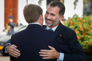 King Felipe VI of Spain is welcomed by King Willem-Alexander of the Netherlands upon his arrival to Noordeinde palace on October 15, 2014 in The Hague, Netherlands. Spain's royal couple are in the Netherlands for a one-day official visit and will meet with Dutch Prime Minister Mark Rutte later today.