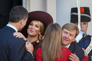 King Willem-Alexander (R) of the Netherlands and Queen Maxima of the Netherlands (2nd L) kiss King Felipe VI of Spain and Queen Letizia of Spain goodbye after a lunch at Noordeinde palace on October 15, 2014 in The Hague, Netherlands. Spain's royal couple are in the Netherlands for a one-day official visit.