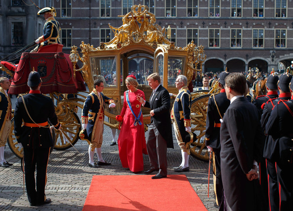 King Willem-Alexander of the Netherlands arrives with Queen Maxima in the golden carriage at the seat of the Dutch government on September 16, 2014 in The Hague, Netherlands. The Dutch King officialy opened the parliamentary year by reading a speech outlining the government plans for the year ahead.