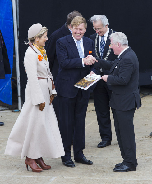 King Willem-Alexander of The Netherlands and Queen Maxima of The Netherlands receive a book about the town of Scheveningen from Henk Grootveld (R) during the 200th anniversary of the kingdom of The Netherlands on November 30, 2013 in The Hague, Netherlands.