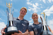 (L) Chip Peterson and Christine Jennings of the United States pose with the trophy after win the King and Queen of the Sea 2015 at Copacabana beach on December 13, 2015 in Rio de Janeiro, Brazil.