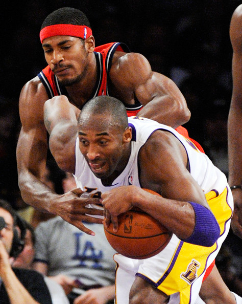 New Jersey Nets v Los Angeles Lakers [photograph,basketball player,muscle,sports,championship,athlete,team sport,player,basketball moves,chest,barechested,kobe bryant,courtney lee,user,note,ball,foul,los angeles lakers,new jersey nets,basketball game]