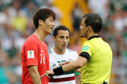Referee Milorad Mazic speaks with Sungyueng Ki of Korea Republic during the 2018 FIFA World Cup Russia group F match between Korea Republic and Mexico at Rostov Arena on June 23, 2018 in Rostov-on-Don, Russia.