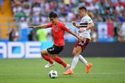 Yong Lee of Korea Republic battles for possession with Javier Hernandez of Mexico during the 2018 FIFA World Cup Russia group F match between Korea Republic and Mexico at Rostov Arena on June 23, 2018 in Rostov-on-Don, Russia.