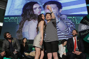 Actress Megan Fox and a fan pose for photographs at the Premiere of Paramount Pictures' 'TEENAGE MUTANT NINJA TURTLES' at CGV Yeoido, on August 26, 2014 in Seoul, South Korea.