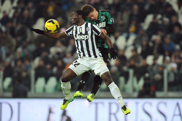 Juventus v US Sassuolo Calcio - Serie A [player,sports equipment,football player,tournament,team sport,sports,sport venue,ball game,championship,football,juventus,us sassuolo calcio,serie a,serie a match between juventus and us sassuolo calcio at juventus arena,l,italy,turin,kwadwo asamoah of juventus,marcello gazzola of us sassuolo calcio go up]