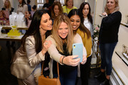 Kyle Richards (L) and guests attend the Kendra Gives Back event at Kendra Scott on February 12, 2020 in Century City, California.