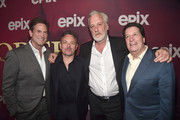 Michael Wright, Danny Cannon,  Bruno Heller and Peter Roth attend the premiere of Epix's 'Pennyworth' at Harmony Gold on July 24, 2019 in Los Angeles, California.