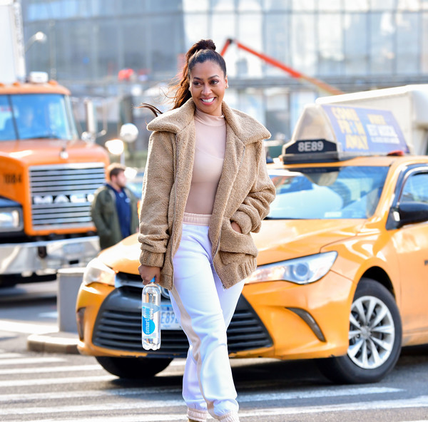 La La Anthony Is Spotted Sipping on Smartwater in NYC [la la anthony,smartwater,smartwater,street fashion,clothing,vehicle,fashion,car,transport,mid-size car,automotive design,outerwear,vehicle door,nyc]