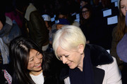 Cosmopolitan magazine executive editor Joyce Chang (L) and Cosmopolitan magazine editor in chief Joanna Coles attend the Lacoste fashion show during Mercedes-Benz Fashion Week Fall 2014 at The Theatre at Lincoln Center on February 8, 2014 in New York City.