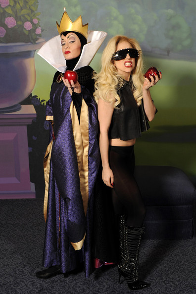 """Lady Gaga In this handout photo provided byWalt Disney World, Grammy Award-winning singer Lady Gaga (R) poses with the Evil Queen from Disney's animated film """"Snow White"""" at the Magic Kingdom park at Walt Disney World Resort onApril 16, 2011 in Lake Buena Vista, Florida."""