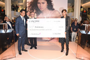 Lancôme Ambassador Zendaya appears on stage with philanthropy check as Lancôme US President Suriya Parksuwan and CEO, ProLiteracy Kevin Morgan look on, as she celebrates Idôle Fragrance launch at Macy's Herald Square on September 04, 2019 in New York City.