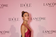A guest attends the Lancôme announces Zendaya as face of new Idôle fragrance at Palais D'Iena on July 02, 2019 in Paris, France.