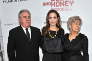 "Angelina Jolie (center) with Bill Pitt and Jane Pitt attend the premiere of ""In the Land of Blood and Honey"" at the School of Visual Arts on December 5, 2011 in New York City."