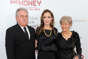 "Angelina Jolie (center) with Bill Pitt (L) and Jane Pitt pose for a photo during the premiere of ""In the Land of Blood and Honey"" at the School of Visual Arts on December 5, 2011 in New York City."