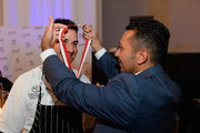 Barcelona CEO Alan Semsar (R) gives chef Steve Young the Las Vegas Food & Wine Festival Top Chef award during the Las Vegas Food & Wine Festival at SLS Las Vegas Hotel on September 16, 2016 in Las Vegas, Nevada.