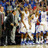 Bill Self Photos - (L-R) Head coach Bill Self and assistant coach Kurtis Townsend, Markieff Morris #21, Travis Releford #24 and Elijah Johnson #15 of the Kansas Jayhawks celebrate late in the team's championship game against the Arizona Wildcats at the Las Vegas Invitational at The Orleans Arena November 27, 2010 in Las Vegas, Nevada. Kansas won 87-79. - Las Vegas Invitational - Day Two