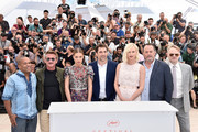 """(L-R) Zubin Cooper, director Sean Penn, Adele Exarchopoulos, Javier Bardem, Charlize Theron, Jean Reno and Jared Harris attend """"The Last Face"""" Photocall during the 69th annual Cannes Film Festival at the Palais des Festivals on May 20, 2016 in Cannes, France."""