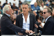 """(FromL) French artistic director Gilles Hertzog, French philosopher, writer and director Bernard-Henri Levy and French producer Francois Margolin pose on May 20, 2016 during a photocall for the film """"Peshmerga"""" at the 69th Cannes Film Festival in Cannes, southern France.  / AFP / ALBERTO PIZZOLI"""