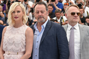 """(FromL) South African-US actress Charlize Theron, French actor Jean Reno and British actor Jared Harris pose on May 20, 2016 during a photocall for the film """"The Last Face"""" at the 69th Cannes Film Festival in Cannes, southern France.  / AFP / ALBERTO PIZZOLI"""