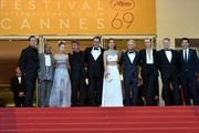 """(FromL) US producer Matt Palmieri, US actor Zubin Cooper, Sean Penn's daughter Dylan Frances Penn, US actor and director Sean Penn, French actor Jean Reno, French actress Adele Exarchopoulos, Sean Penn's son Hopper Jack Penn, South African-US actress Charlize Theron, British actor Jared Harris and Spanish actor Javier Bardem pose as they arrive on May 20, 2016 for the screening of the film """"The Last Face"""" at the 69th Cannes Film Festival in Cannes, southern France.  / AFP / ALBERTO PIZZOLI"""