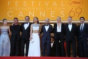"""(FromL) US actress Dylan Penn, US actor and director Sean Penn, French actor Jean Reno, French actress Adele Exarchopoulos, US actor Hopper Penn, South African-US actress Charlize Theron, British actor Jared Harris and Spanish actor Javier Bardem pose as they arrive on May 20, 2016 for the screening of the film """"The Last Face"""" at the 69th Cannes Film Festival in Cannes, southern France.  / AFP / Valery HACHE"""