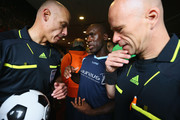 Linesman Gino D'Onorio, Clarence Seedorf of Laureus Allstaers and referee Howard Webb talk in the players tunnel prior to the Laureus KickOffForGood Charity Match between Laureus All Stars against Real Madrid Legends at AFAS Stadiun Alkmaar on September 5, 2015 in Alkmaar, Netherlands.