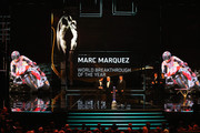 Motor cyclist Marc Marquez accepts his Laureus World Breakthrough of the Year award from Laureus Academy member Giacomo Agostini and Mick Doohan  during the 2014 Laureus World Sports Award show at the Istana Budaya Theatre on March 26, 2014 in Kuala Lumpur, Malaysia.