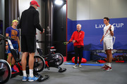 John McEnroe, Captain of Team World, John Isner, Milos Raonic and Denis Shapovalov of Team World speak as they warm up prior to a practice session ahead of the Laver Cup 2019 at Palexpo on September 19, 2019 in Geneva, Switzerland. The Laver Cup will see six players from the rest of the World competing against their counterparts from Europe. Team World is captained by John McEnroe and Team Europe is captained by Bjorn Borg. The tournament runs from September 20-22.