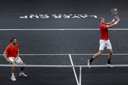 Team World Kevin Anderson of South Africa and Team World Jack Sock of the United States play Team Europe Roger Federer of Switzerland and Team Europe Novak Djokovic of Serbia during their Men's Doubles match on day one of the 2018 Laver Cup at the United Center on September 21, 2018 in Chicago, Illinois.