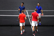 Team World Jack Sock of the United States and Team World Kevin Anderson of South Africa shake hands with Team Europe Novak Djokovic of Serbia Team Europe Roger Federer of Switzerland after defeating them in their Men's Doubles match on day one of the 2018 Laver Cup at the United Center on September 21, 2018 in Chicago, Illinois.