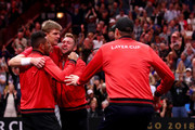 Team World Kevin Anderson of South Africa celebrates with teammates Team World Nick Kyrgios of Australia, Team World Jack Sock of the United States and Team World John Isner of the United States after defeating Team Europe Novak Djokovic of Serbia in his Men's Singles match on day two of the 2018 Laver Cup at the United Center on September 22, 2018 in Chicago, Illinois.