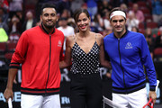 Team World Nick Kyrgios of Australia and Team Europe Roger Federer of Switzerland pose with former tennis player Ana Ivanovic of Serbia prior to their Men's Singles match on day two of the 2018 Laver Cup at the United Center on September 22, 2018 in Chicago, Illinois.