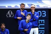 Team Europe Grigor Dimitrov of of Bulgaria, Team Europe Novak Djokovic of Serbia and Team Europe Roger Federer of Switzerland look on during the Men's Singles match on day two of the 2018 Laver Cup at the United Center on September 22, 2018 in Chicago, Illinois.