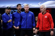 Team Europe Grigor Dimitrov of of Bulgaria, Team Europe Novak Djokovic of Serbia and Team Europe Kyle Edmund of Great Britain celebrate as Team World Captain John McEnroe of the United States walks past during the Men's Singles match between Team Europe Roger Federer of Switzerland and Team World John Isner of the United States on day three of the 2018 Laver Cup at the United Center on September 23, 2018 in Chicago, Illinois.