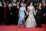 "Florence Pugh, Zhang Ziyi and Caroline Scheufele attend the screening of ""La Belle Epoque"" during the 72nd annual Cannes Film Festival on May 20, 2019 in Cannes, France."