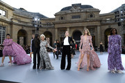 """(L-R) Aishwarya Rai, a model, Camila Cabello, Helen Mirren, Amber Heard, Doutzen Kroes and Liya Kebede pose on the runway during the """"Le Defile L'Oreal Paris""""  Show as part of Paris Fashion Week on September 28, 2019 in Paris, France."""