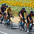 Geraint Thomas Richie Porte Photos - Chris Froome of Great Britain and Team Sky rides amongst his team-mates including Richie Porte of Australia and Team Sky, Ian Stannard of Great Britain and Team Sky, Luke Rowe of Great Britain and Team Sky and Geraint Thomas of Great Britain and Team Sky during stage thirteen of the 2015 Tour de France, a 198.5 km stage between Muret and Rodez, on July 17, 2015 in Rodez, France. - Le Tour de France 2015 - Stage Thirteen