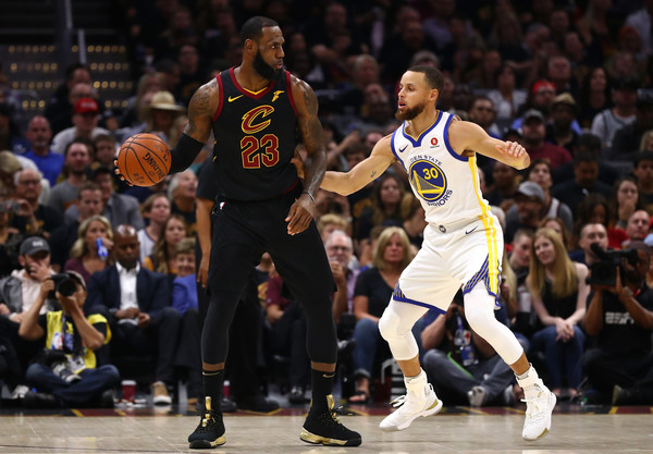 2018 NBA Finals - Game Four [photograph,basketball,sports,basketball player,ball game,player,basketball moves,tournament,team sport,sport venue,game four,lebron james,user,stephen curry,note,ball,nba,cleveland cavaliers,finals]