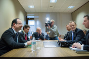 Polish Prime Minister Donald Tusk (2nd R) and French President  Francois Hollande (L) sit during a meeting at the EU Headquarters on the first day of a two-day European Union leaders summit on February 7, 2013 in Brussels, Belgium, European Union leaders are set to duscuss the EU's budget.