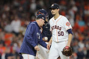 Charlie Morton #50 of the Houston Astros is pulled by manager AJ Hinch in the third inning against the Boston Red Sox during Game Four of the American League Championship Series at Minute Maid Park on October 17, 2018 in Houston, Texas.