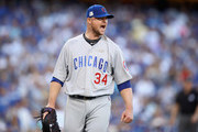 Jon Lester #34 of the Chicago Cubs reacts during their game against the Los Angeles Dodgers during Game Two of the National League Championship Series at Dodger Stadium on October 15, 2017 in Los Angeles, California.