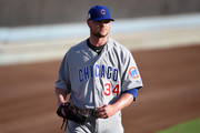 Jon Lester #34 of the Chicago Cubs looks on before game two of the National League Championship Series against the Los Angeles Dodgers at Dodger Stadium on October 15, 2017 in Los Angeles, California.